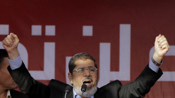 """FILE - In this Friday, June 29, 2012 file photo, Egypt's President-elect Mohammed Morsi talks to his supporters at Tahrir Square, the focal point of Egyptian uprising, during his speech in Cairo, Egypt. Egyptian officials say security authorities leaked a recording of a private conversation between ousted President Mohammed Morsi and his lawyer on the sidelines of his trial, in which Morsi says protests by his supporters and the crackdown on them are """"useless."""" (AP Photo/Amr Nabil, File)"""