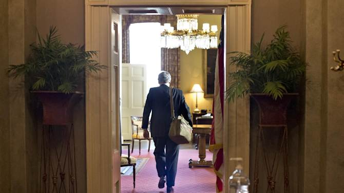 "Senate Minority Leader Mitch McConnell of Kentucky, arrives at his office in the Capitol as he and Senate Majority Leader Harry Reid of Neveda try to negotiate a legislative solution to avoid the so-called ""fiscal cliff,"" in Washington, Sunday, Dec. 30, 2012.   (AP Photo/J. Scott Applewhite)"
