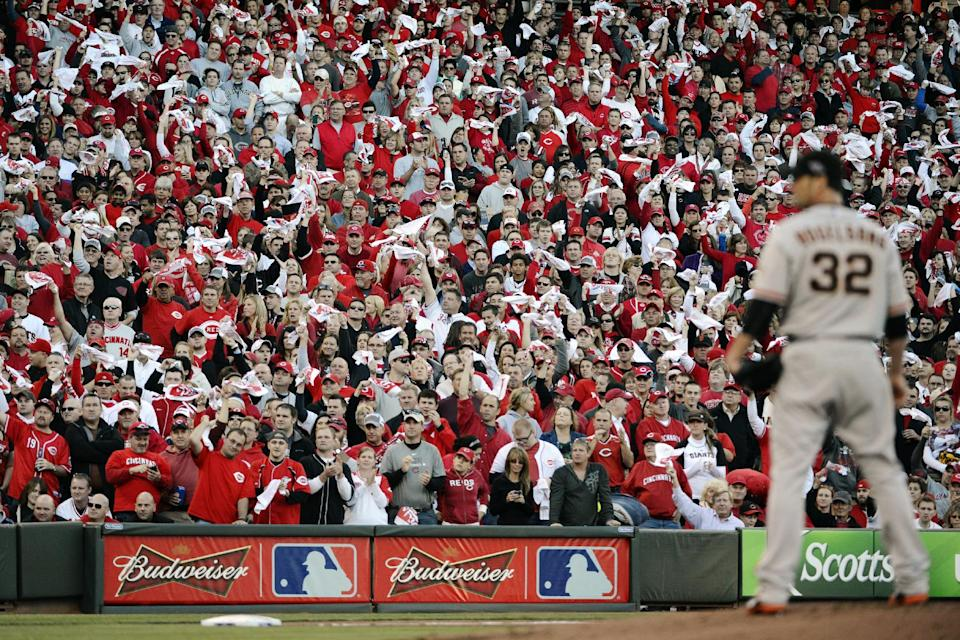San Francisco Giants starting pitcher Ryan Vogelsong (32) prepares to throw against the Cincinnati Reds in the first inning during Game 3 of the National League division baseball series, Tuesday, Oct. 9, 2012, in Cincinnati. (AP Photo/Michael Keating)