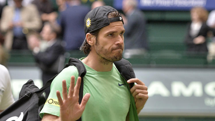 Germany's Tommy Haas leaves disappointed after losing  his semifinal tennis match against Switzerland's Roger Federer at the ATP Gerry Weber Open tournament  in Halle  Westphalia, Germany, Saturday, June 15, 2013. (AP Photo/Martin Meissner)