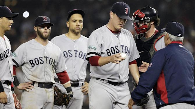 Boston Red Sox relief pitcher Andrew Bailey hands the ball to manager Bobby Valentine as he leaves the mound during the ninth inning of a baseball game against the New York Yankees, Tuesday, Oct. 2, 2012, in New York. (AP Photo/Frank Franklin II)