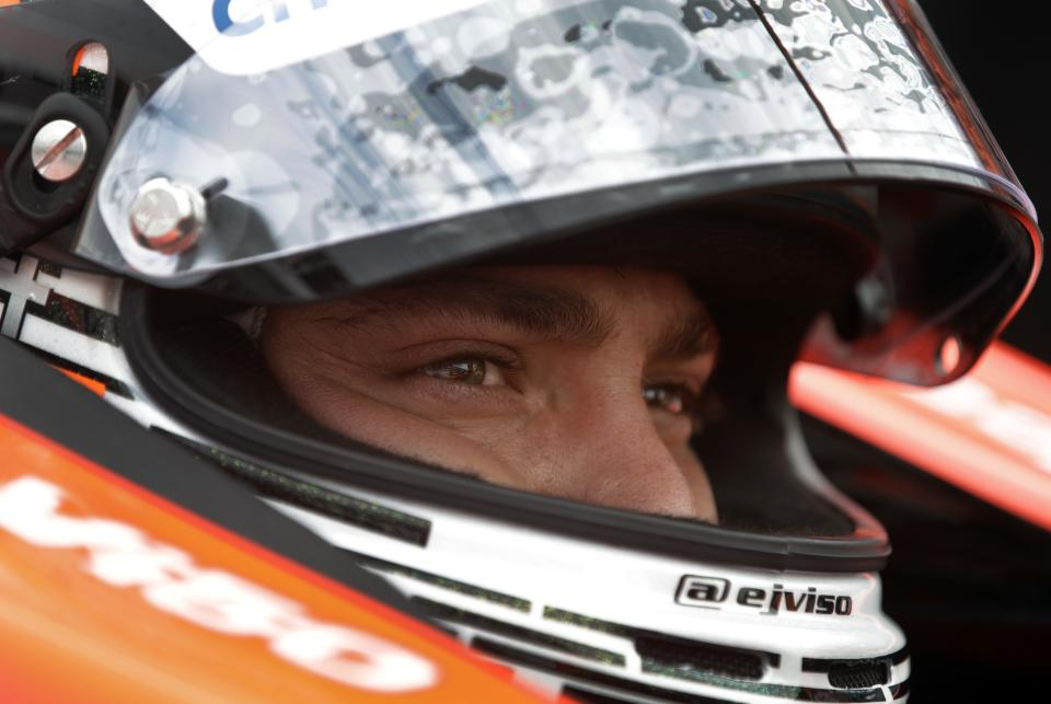 E.J. Viso, of Venezuela, sits in his car during a break in practice for the Indianapolis 500 auto race at the Indianapolis Motor Speedway in Indianapolis, Friday, May 17, 2013. (AP Photo/Darron Cummings)