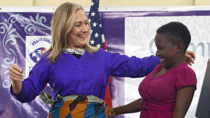 FILE - In this Aug. 5, 2012, file photo, Secretary of State Hillary Rodham Clinton embraces Triza Lapani, 17, after  the teen helped Clinton put on a chitenje cloth, a traditional skirt, after speaking at Camp GLOW (Girls Leading Our World) run by the Peace Corps, in Lilongwe, Malawi. Clinton's plan for 2013 was simple. She'd embark on an epic swansong around the world as secretary of state, a dizzying itinerary of east-west and north-south flights that would take her past 1 million miles in the air at the helm of American diplomacy and perhaps break her own record of 112 countries visited while in the post. Her health got in the way and she was sidelined by circumstances beyond her control. (AP Photo/Jacquelyn Martin, File, File, Pool)