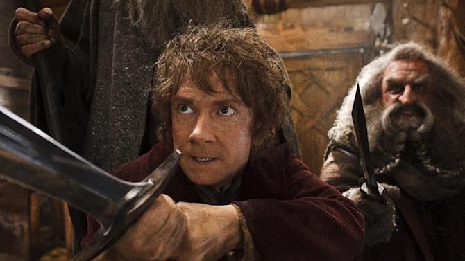 """This image released by Warner Bros. Pictures shows Martin Freeman, left, and John Callen in a scene from """"The Hobbit: The Desolation of Smaug."""" """"The Hobbit: The Desolation of Smaug"""" held off """"Anchorman 2"""" on a busy weekend at the box office. According to final studio estimates Monday, Dec. 23, 2013, Peter Jackson's """"Hobbit"""" sequel took in $31.5 million in its second weekend of release. That topped Will Ferrell's """"Anchorman"""" sequel, which nevertheless opened strongly in second place. (AP Photo/Warner Bros. Pictures, Mark Pokorny)"""