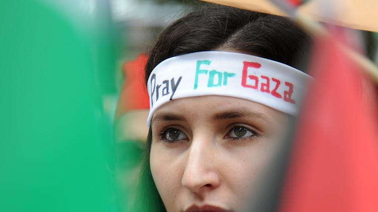 "A woman wears a head band reading ""Pray for Gaza"" during a pro-Palestine demonstration ""Solidarity with Gaza"" in Munich, Germany, Saturday July 26, 2014. Several hundred people took part to protest against Israel's actions in Gaza (AP Photo/dpa,Tobias Hase)"