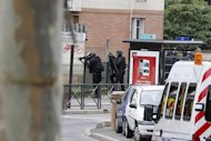 French police at the scene of the hostage siege at a school in the Paris suburb of Vitry-sur-Seine. French police have arrested an armed man who took a parent hostage at a French school. The armed man was arrested shortly after releasing his captive, a police source told AFP