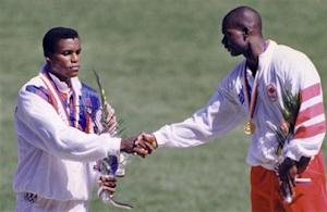 Johnson of Canada shakes hands with silver medalist Lewis of U.S. after winning the men's 100m at the Olympics in Seoul