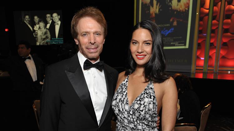 Jerry Bruckheimer, left, and Olivia Munn attend the presentation of the 27th Annual American Cinematheque Award to Jerry Bruckheimer on Thursday, Dec. 12, 2013, in Beverly Hills, Calif. (Photo by John Shearer/Invision for American Cinematheque/AP Images)