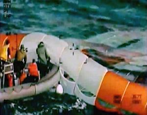 In this image provided by NASA, following splashdown …