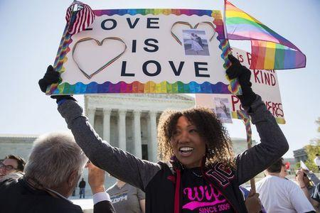 Cantu holds a sign supporting same sex marriage in front of the Supreme Court in Washington