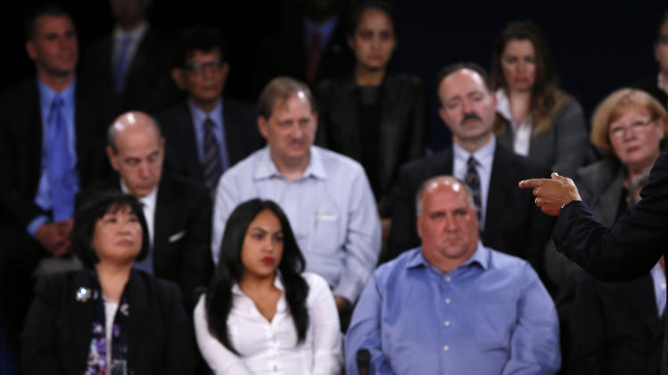Members of the audience look on as U.S. President Barack Obama speaks as he debates Republican presidential nominee Mitt Romney during the second U.S. presidential debate in Hempstead