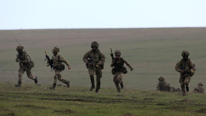 "British soldiers take part in the ""Wind Spring 15"" military exercises at Smardan shooting range"