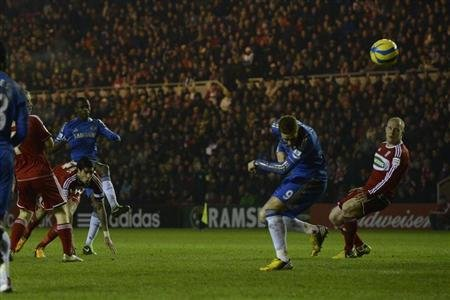 Chelsea's Ramires' (3rd L) shot hits teammate Fernando Torres (2nd R) and deflects into the net for a goal during their English FA Cup soccer match against Middlesbrough in Middlesbrough, northern Eng