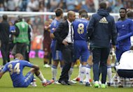 Chelsea manager Roberto Di Matteo (third left) stands with players after losing against Manchester City in the FA Community Shield football match at Villa Park, Birmingham, on August 12. Di Matteo admits Chelsea's main target this season is to close the gap on Manchester City and Manchester United as the European champions kick off their Premier League campaign at Wigan