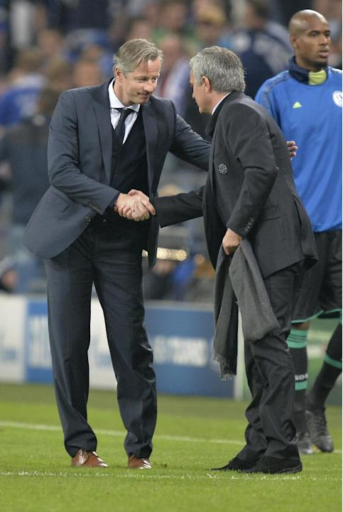 Schalke head coach Jens Keller, left, congratulates Chelsea's manager Jose Mourinho after the Champions League group E soccer match between FC Schalke 04 and Chelsea FC in Gelsenkirchen, Germany, Tues
