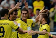 Dortmund's striker Robert Lewandowski, defender Mats Hummels, midfielder Sebastian Kehl and midfielder Jakub Blaszczykowski celebrate after scoring during the German first division Bundesliga football match against Bayer 04 Leverkusen. Dortmund enjoyed a convincing 3-0 win to go third in the Bundesliga