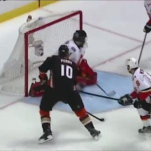 Perry curls around the net and beats Hiller