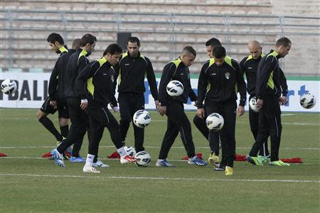 Jordanian players control balls during their final training session at