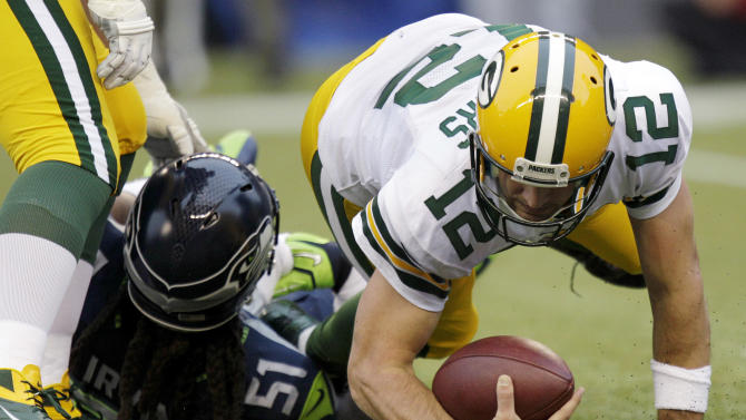 Seattle Seahawks defensive end Bruce Irvin (51) sacks Green Bay Packers quarterback Aaron Rodgers (12) for the second time in the first half of an NFL football game, Monday, Sept. 24, 2012, in Seattle. (AP Photo/Ted S. Warren)