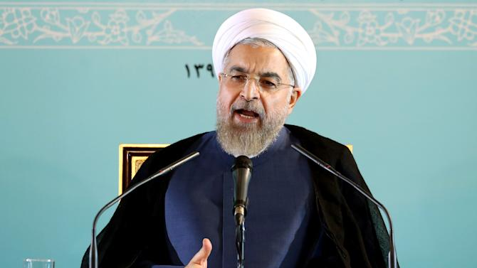 Iranian President Hassan Rouhani speaks during a press conference in Tehran, Iran, Saturday, Aug. 30, 2014. Rouhani declined to answer a question about a detained Washington Post journalist, Jason Rezaian. Rezaian and his wife Yeganeh Salehi, a correspondent for the Abu Dhabi-based daily newspaper The National, who have been held for more than a month. Iranian officials have not specifically said why Rezaian and his wife were detained. (AP Photo/Ebrahim Noroozi)