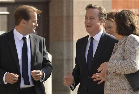 Britain's Prime Minister Cameron arrives on the first day of the Conservative Party annual conference in Manchester northern England