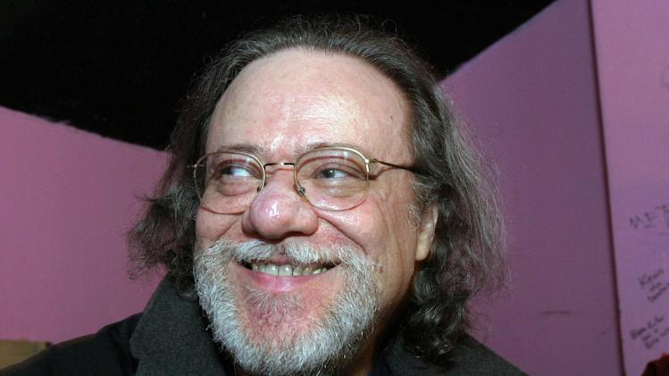 CORRECTS AGE TO 65 AND REMOVES REFERENCE TO WIFE - FILE - In this Jan. 8, 2005, file photo, Tommy Ramone, ex-drummer and manager of The Ramones, smiles as he is interviewed backstage at the Knitting Factory in New York. A business associate says Ramone, a co-founder of the seminal punk band The Ramones and the last surviving member of the original group, has died. Dave Frey, who works for Ramones Productions and Silent Partner Management, confirmed that he died on Friday, July 11, 2014. Ramone was 65. (AP Photo/Tina Fineberg, File)