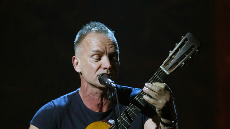 """In this photo provided by NBC, Sting performs during """"Hurricane Sandy: Coming Together"""" Friday, Nov. 2, 2012, in New York. Hosted by Matt Lauer, the event is heavy on stars identified with New Jersey and the New York metropolitan area, which took the brunt of this week's deadly storm. (AP Photo/NBC, Heidi Gutman)"""