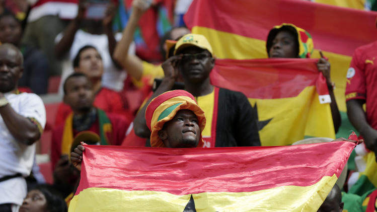 Fans of Ghana listen to the national anthem before the group G World Cup soccer match between Portugal and Ghana at the Estadio Nacional in Brasilia, Brazil, Thursday, June 26, 2014