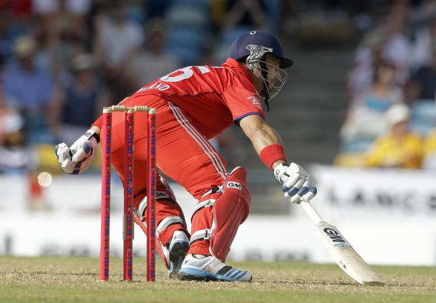 England's Michael Lumb runs during the first T20 International cricket match against West Indies at the Kensington Oval in Bridgetown, Barbados, Sunday, March 9, 2014. (AP Photo/Ricardo Mazalan)