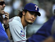 Yu Darvish of the Texas Rangers watches the game between the Chicago White Sox and the Texas Rangers at US Cellular Field in Chicago, Illinois. Darvish was named to the American League All Star Team today