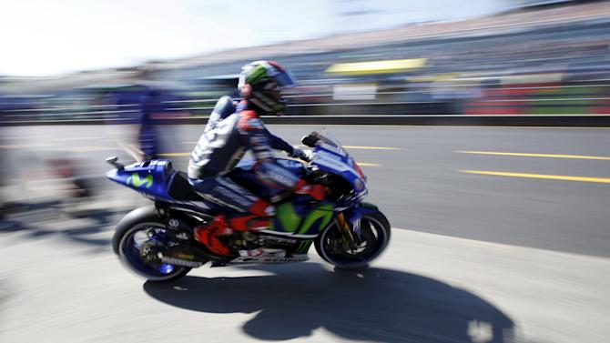 Yamaha MotoGP rider Lorenzo of Spain goes out from his pit garage during a free practice session at the Twin Ring Motegi circuit ahead of Sunday's Japanese Grand Prix in Motegi, Japan