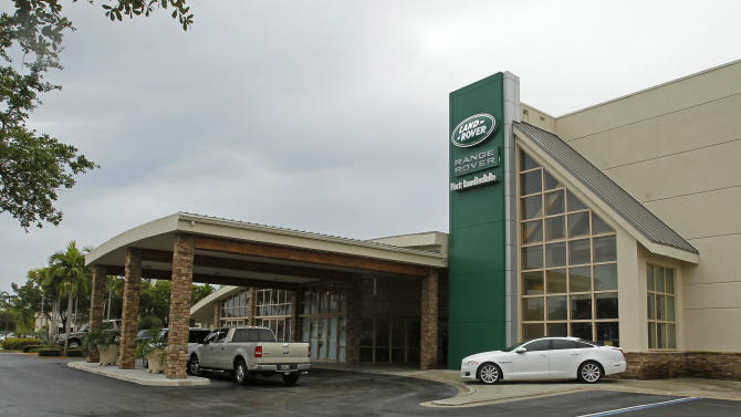 This Tuesday, July 17, 2012 photo, shows a Land Rover dealership is shown in Pompano Beach, Fla. AutoNation Inc. said Thursday, July 19, 2012,  that its second-quarter net income rose 9.3 percent as the nation's largest dealership chain sold more new and used vehicles. (AP Photo/Alan Diaz)