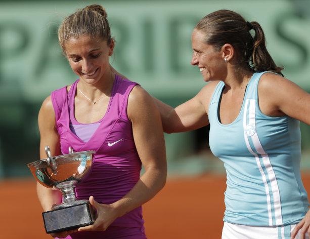 Italy's Sara Errani, left, and Roberta Vinci react with their cup after defeating Russia's Maria Kirileko and Nadia Petrova during their women's doubles final match in the French Open tennis tournament at the Roland Garros stadium in Paris, Friday, June 8, 2012. Errani and Vinci won 4-6, 6-4, 6-2. (AP Photo/Bernat Armangue)