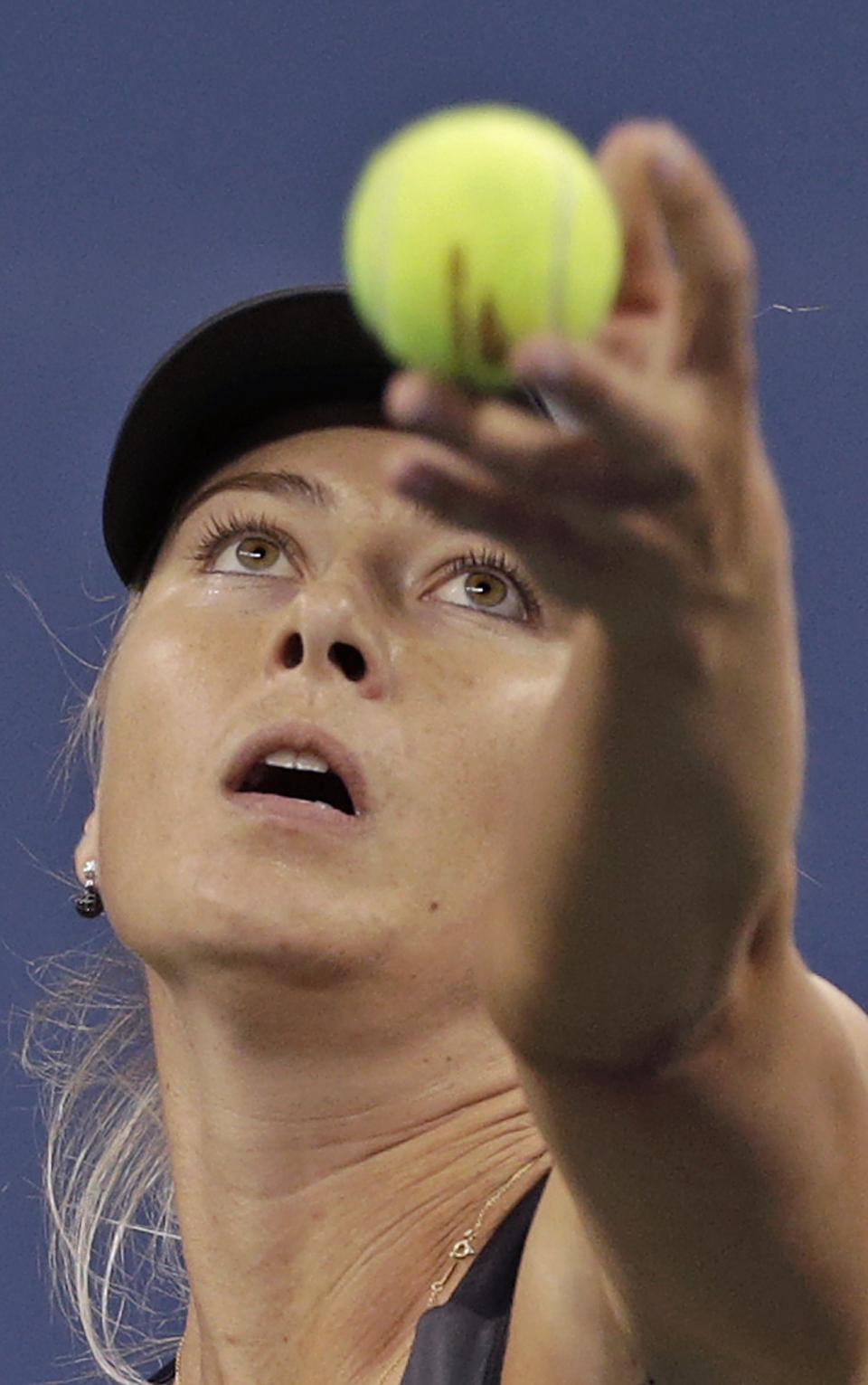 Maria Sharapova, of Russia, tosses the ball on her serve to Lourdes Dominguez Lino, of Spain, in the second round of play at the U.S. Open tennis tournament on Wednesday, Aug. 29, 2012, in New York. (AP Photo/Charles Krupa)