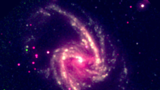 This image released by Arcetri Astrophysical Observatory, shows a supermassive black hole in the nearby spiral galaxy NGC 1365. A study published Thursday in the journal Nature calculated the spin rate of the black hole and found it's rotating close to the speed of light. (AP Photo/Guido Risaliti, Arcetri Astrophysical Observatory)