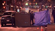 Police cover up the body of a pedestrian killed in an East Vancouver intersection on Tuesday night.