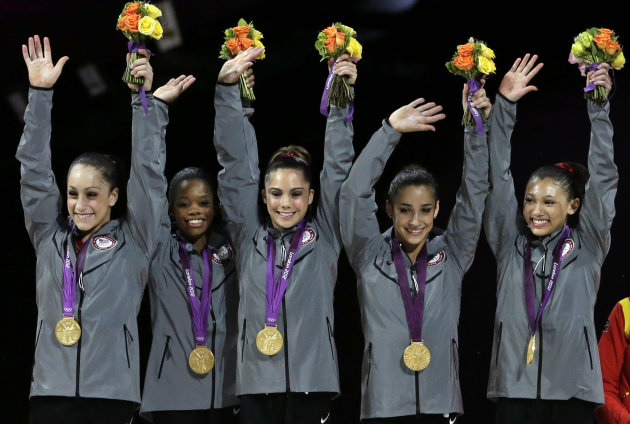 FILE-In this Tuesday, July 31, 2012, file photo, U.S. gymnasts,from left, Jordyn Wieber, Gabrielle Douglas, McKayla Maroney, Alexandra Raisman, Kyla Ross raise their hands on the podium during the medal ceremony during the Artistic Gymnastic women&#39;s team final at the 2012 Summer Olympics, Tuesday, July 31, 2012, in London. With the gymnastics competition over, the U.S. women&#39;s gymnastics team is beginning to realize just how big a deal they&#39;ve become back home. (AP Photo/Gregory Bull)