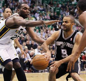San Antonio Spurs point guard Tony Parker (9) of France passes off the ball as Utah Jazz center Al Jefferson (25) pressures during the first half of Game 4 in the first-round NBA basketball playoff series, Monday, May 7, 2012, in Salt Lake City. (AP Photo/Colin E Braley)