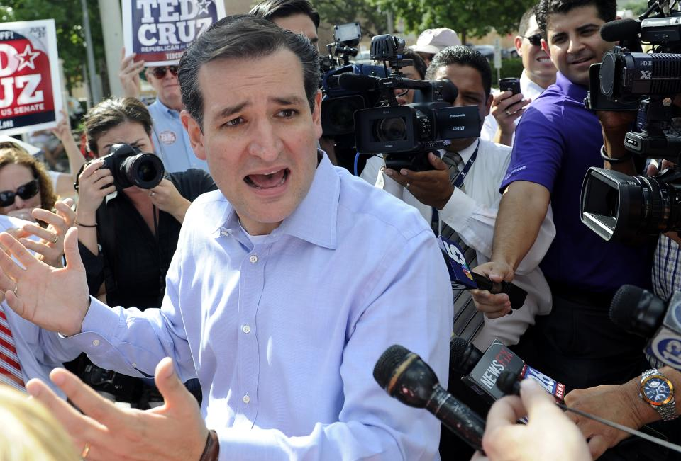 Former Texas Solicitor General Ted Cruz  answers questions from the media at a voting precinct Tuesday, July 31, 2012, in Houston. Cruz faces Lt. Gov. David Dewhurst in the Republican primary runoff election for the Republican nomination for the U.S. Senate. (AP Photo/Pat Sullivan)