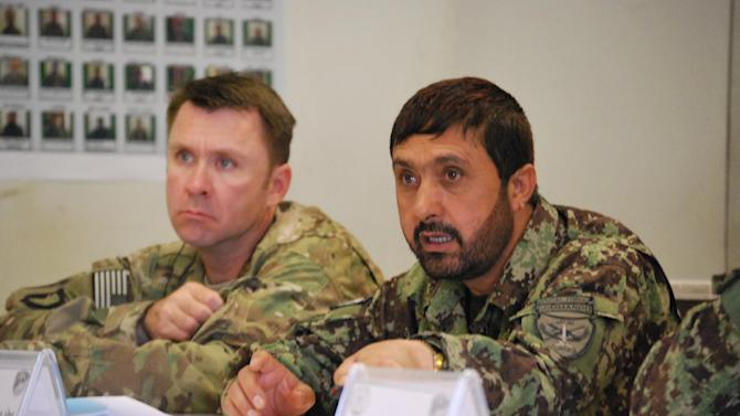 In a Wednesday, May 15, 2013, photo U.S. Army Lt. Col. Matthew Stader, left, listens to a briefing in Jalalabad, Afghanistan, alongside his Afghan counterpart, Brig. Gen. Dadan Luwang, commander of the 4th Brigade, 201st Corps of the Afghan National Army. Stader, of Annapolis, Md. and assigned to the 101st Airborne Division, is serving as an adviser to the Afghan brigade during the transition to leave Afghan forces in charge of security ahead of the 2014 drawdown of U.S. forces. (AP Photo/Kristin M. Hall)