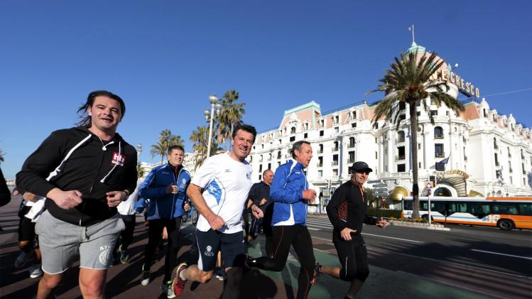 Christian Estrosi, Mayor of Nice and conservative UMP political party candidate for the mayoral election in Nice, jogs in Nice
