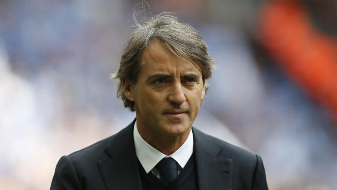 Manchester City's manager Roberto Mancini looks on during a line up at the start of their English FA Cup final soccer match against Wigan Athletic at Wembley Stadium, London, Saturday, May 11, 2013. (AP Photo/Jon Super)