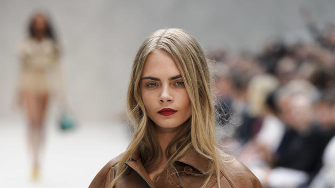 A model displays a design from Burberry Prorsum's Spring/Summer 2013 collection, in Kensington, west London, during London Fashion Week, Monday Sept. 17, 2012.  (AP Photo/Jonathan Short)
