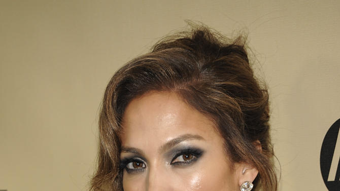 Actress and singer Jennifer Lopez arrives at the Weinstein Company Golden Globe After Party at the Beverly Hilton Hotel on Sunday Jan. 13, 2013, in Beverly Hills, Calif. (Photo by Dan Steinberg/Invision/AP)
