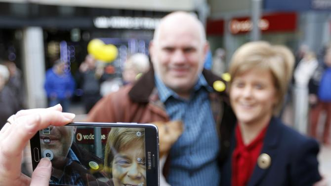 Nicola Sturgeon, leader of the Scottish National Party, poses for a selfie during an election visit to Kirkcaldy in Scotland