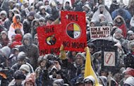 First Nations protestors take part in an &quot;Idle No More&quot; demonstration on Parliament Hill in Ottawa January 28, 2013. REUTERS/Chris Wattie
