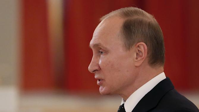 Russia's President Vladimir Putin delivers a speech during a ceremony of receiving diplomatic credentials from foreign ambassadors at the Kremlin in Moscow