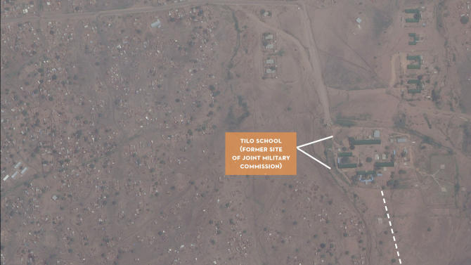 In this Digital Globe satellite image made available by the US monitoring group the Satellite Sentinel Project Thursday July 14 2011 and analyzed by the Harvard Humanitarian Initiative, a dug-up site near Kadugli town in a sealed-off region of Sudan appears to be a mass grave, offering the first aerial photographs from a conflict zone that outside observers can't access. The group said it had photographic evidence and witness testimony indicating that systematic killings and mass burials are taking place in Southern Kordofan state, where Sudan's Arab military has been targeting a black ethnic minority loyal to the military of the newly independent Republic of South Sudan. Text and graphics applied to images by the source. (AP Photo/DigitalGlobe) EDITORIAL USE ONLY NO SALES