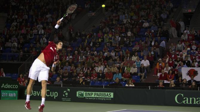 Canada's Raonic serves to Japan's Ito during their Davis Cup tennis match at the Doug Mitchell Thunderbird Sports Centre in Vancouver