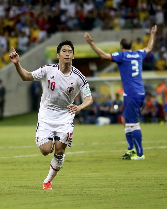 Japan's Shinji Kagawa celebrates after scoring against Italy during their Confederations Cup Group A soccer match at the Arena Pernambuco in Recife